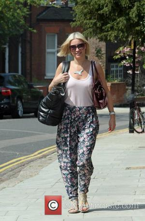 Denise Van Outen is seen leaving her home in a floral spring outfit and a Chanel tote bag London, England...