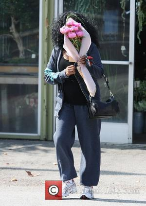 Diana Ross carries a bunch of flowers whilst out and a bout in West Hollywood West Hollywood, California - 25.06.11
