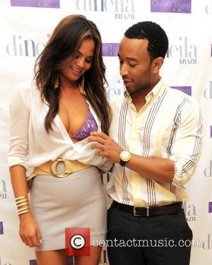 Chrissy Tiegen and John Legend  Miami Swim Spring/Summer 2012 DiNeila Brazil presentation at The Penthouse at The Raleigh Hotel...