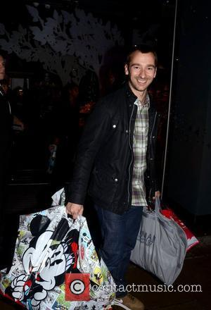 Charlie Condou leaving the Disney store on Oxford Street London, England - 02.11.11