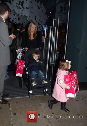 Tina Hobley leaving the Disney store on Oxford Street with her children London, England - 02.11.11