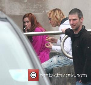 Karen Gillan smoking on the set of the BBC sci-fi series Doctor Who filming on location at Temple of Peace...