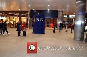 Bemused shoppers walk past the Doctor Who Tardis outside Westfield Stratford City station London, England - 21.11.11