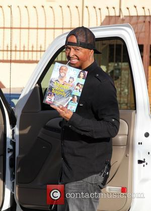 Jr Martinez poses with a copy of 'People' magazine with him on the front cover 'Dancing With The Stars' celebrities...