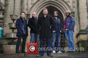 Elbow  outside Manchester Cathedral, where they will play in concert later tonight. Manchester, England - 27.10.11