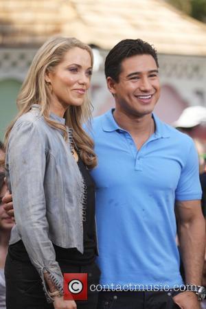 Elizabeth Berkley and Mario Lopez