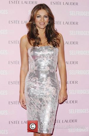 Elizabeth Hurley Suffers Mystery Shoulder Injury