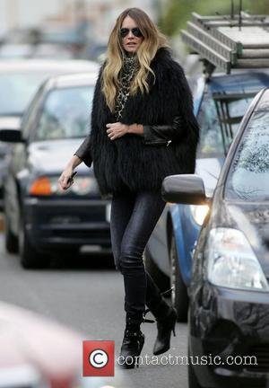 Elle Macpherson after dropping her children at school London, England - 28.01.11