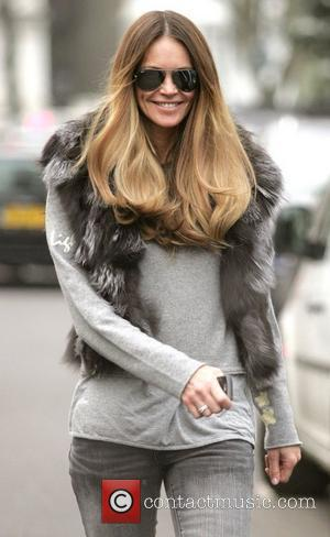 Elle Macpherson makes her way home after taking her children to school London, England - 09.02.11