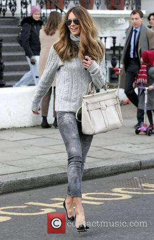 Elle Macpherson makes her way home after taking her children to school London, England - 14.03.11