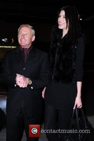 Publicist Elliot Mintz outside BOA Steakhouse with a tall woman Los Angeles, California - 21.02.11