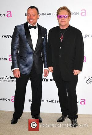 Elton John, David Furnish and Academy Awards