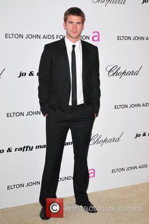 Liam Hemsworth and Elton John