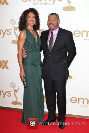 Gina Torres and Laurence Fishburne  The 63rd Primetime Emmy Awards, held at Nokia Theatre L.A. LIVE - Arrivals Los...