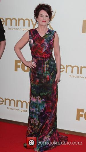 Megan Mullally  The 63rd Primetime Emmy Awards, held at Nokia Theatre L.A. LIVE - Arrivals Los Angeles, California -...