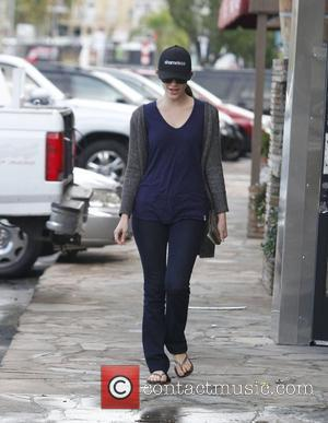 Actress Emmy Rossum wearing a cap promoting her hit show 'Shameless' and wearing flip-flops while out and about in Studio...