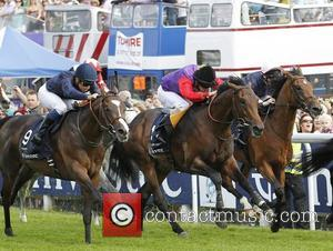 Jockey Mickael Barzalona and his horse Pour Moi wins the the Investec Derby  at Epsom Racecourse for The Derby...