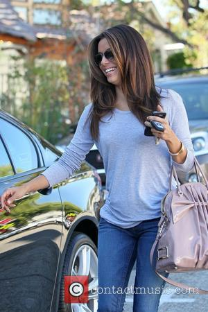 Eva Longoria departs the Ken Paves salon in West Hollywood carrying a pink Valentino handbag Los Angeles, California - 13.10.11