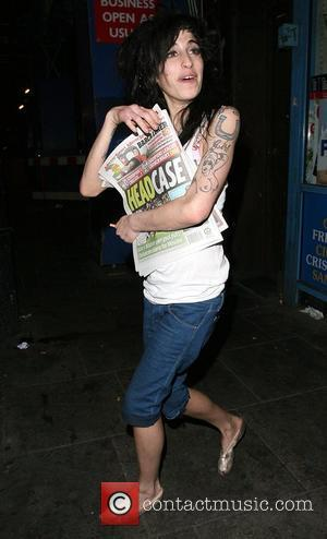 Amy Winehouse and a female friend do a spot of late night shopping, having left a bar in Camden at...