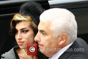 Amy Winehouse and Mitch Winehouse Amy Winehouse arriving at City of Westminster Magistrates Court to face charges of assault London,...