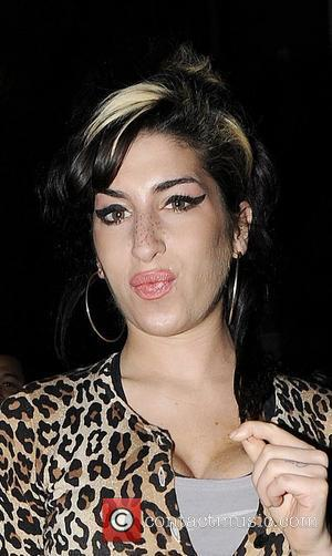 Amy Winehouse pouting and showing off her fuller set of lips as she leaves a Doctor's Surgery London, England -...