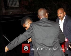 Usher aka Usher Raymond IV  Fashion Night Out - Dolce & Gabbana launch the Passion Duo lipstick - Outside...