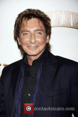 Barry Manilow Opening night of the Broadway musical production of 'Follies' at the Marquis Theatre - Arrivals New York City,...