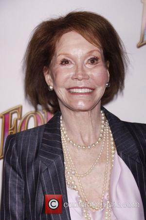 Actress Mary Tyler Moore put on a brave face to attend the opening night of pal Bernadette Peters' stint in...