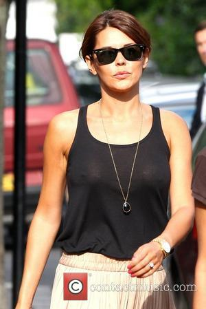 Danielle Lineker wearing a see through top Gary Lineker and wife Danielle Lineker aka Danielle Bux with their Dog out...