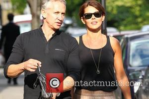 Gary Lineker and wife Danielle Lineker aka Danielle Bux with their Dog out and about in west London. Gary holding...