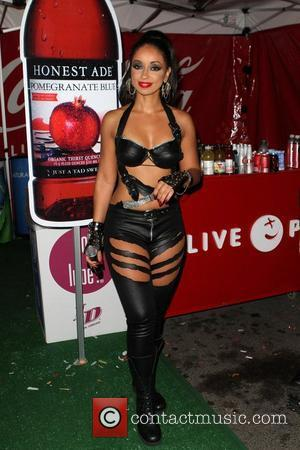 Mya Offers Up Dinner Date For Charity Auction