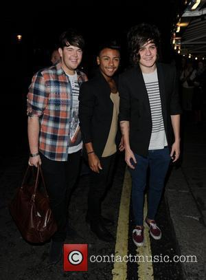 X Factor finalists Craig Colton, Marcus Collins and Frankie Cocozza Celebrities arrive at The Royal Albert Hall to watch George...