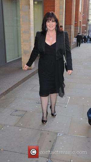 Coleen Nolan smoking a cigarette  arrives for the world premiere of 'Ghost' at the Opera house Manchester, England -...