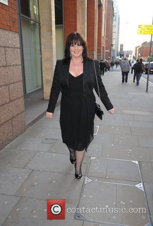 Coleen Nolan smoking a cigarette arrives for the world premiere of 'Ghost' at the Opera house Manchester, England - 12.04.11