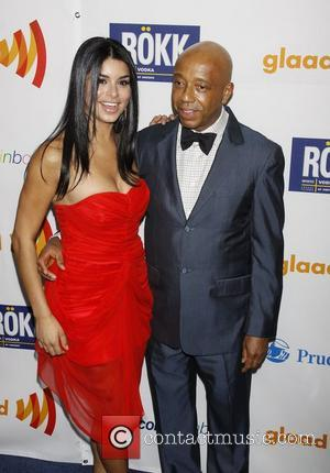 Rima Fakih and Russell Simmons