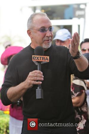 Emilio Estefan Gloria Estefan makes an appearance on 'Extra' with Mario Lopez at The Grove in Hollywood Los Angeles, California...