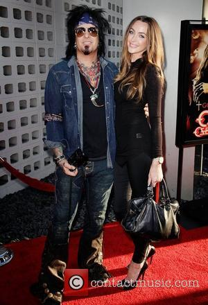 Nikki Sixx and Courtney Bingham Screening of God Bless Ozzy Osbourne to Benefit The Musicares Map Fund at the ArcLight...