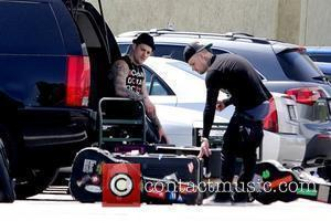 Joel Madden and Benji Madden picking up their instruments in Studio City Los Angeles, California – 12.05.11