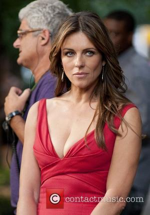 Elizabeth Hurley Defends Shane Warne Over Photos