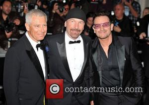 Adam Clayton, The Edge and Bono of U2 2011 GQ Men of the Year Awards held at the Royal Opera...