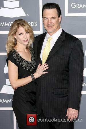 Guest and Patrick Warburton The 53rd Annual GRAMMY Awards at the Staples Center - Red Carpet Arrivals Los Angeles, California...