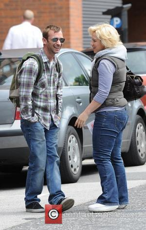 Charlie Condou and Katy Cavanagh  share a laugh outside Granada Studios Manchester, England - 14.07.11
