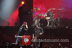 Axl Rose and Guitarist/ songwriter Dj Ashba of Guns N' Roses performs at the American Airlines Arena during his North...