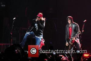 Axl Rose and Richard Fortus of Guns N' Roses performs at the American Airlines Arena during his North American Tour...