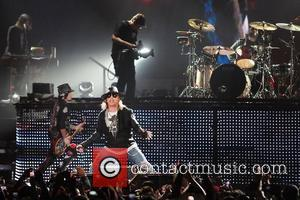 Guitarist/ songwriter Dj Ashba and Axl Rose of Guns N' Roses performs at the American Airlines Arena during his North...
