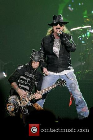 Axl Rose and DJ Ashba  Guns N' Roses perform on stage at Copps Coliseum in Hamilton, Ontario. Hamilton, Canada...