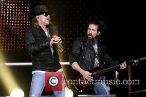 Axl Rose and Ron 'Bumblefoot' Thal Guns N' Roses perform on stage at Copps Coliseum in Hamilton, Ontario. Hamilton, Canada...