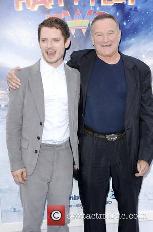 Elijah Wood, Robin Williams and Grauman's Chinese Theatre