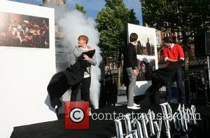 James and Oliver Phelps with Rupert Grint Harry Potter actors Rupert Grint and James and Oliver Phelps open a Harry...