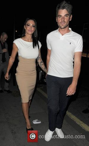 Jodie Marsh and a male companion out and about in Mayfair. London, England - 31.05.11